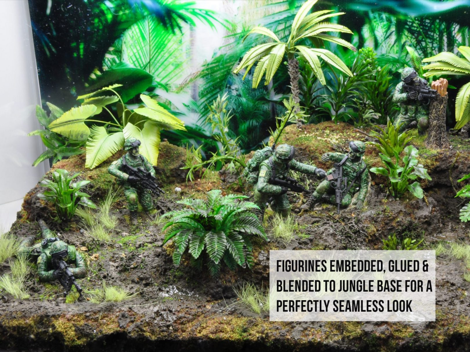 Miniature Stories Diorama with figurines glued down and blended into jungle ground