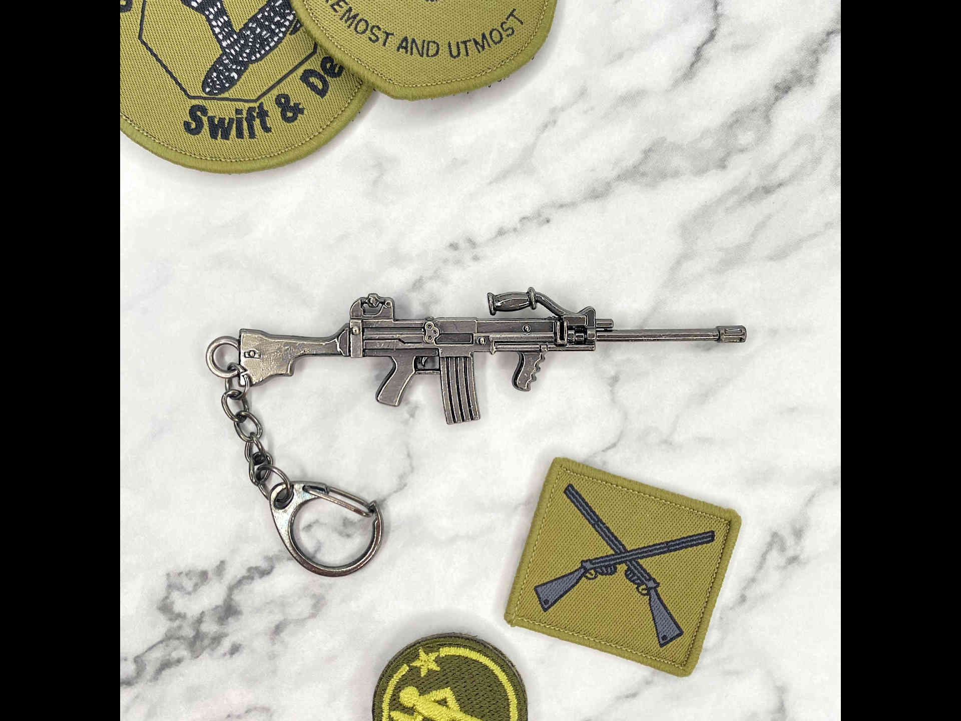 Ultimax 100 SAW Keychain (Cover)